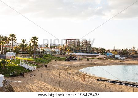 Protaras, Cyprus - February, 15, 2017. Construction's cars working on the construction of a new hotel in Protaras. Urban scene