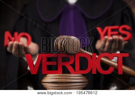 Verdict, Justice and law concept. Male judge in a courtroom