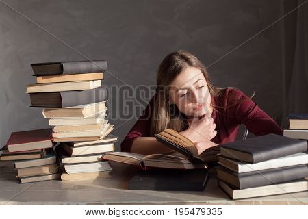 girl reading book prepares for the exam in the library 2