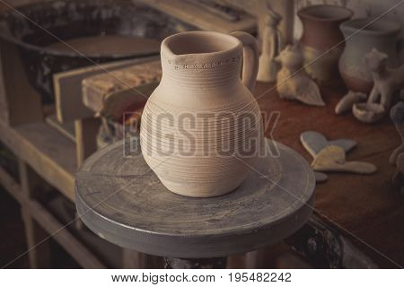 Clay jug on a potter's wheel close-up. Copy spase