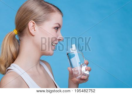 Woman Holding And Drinking A Glass Of Water