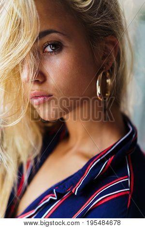 Confident Blonde In Golden Earrings