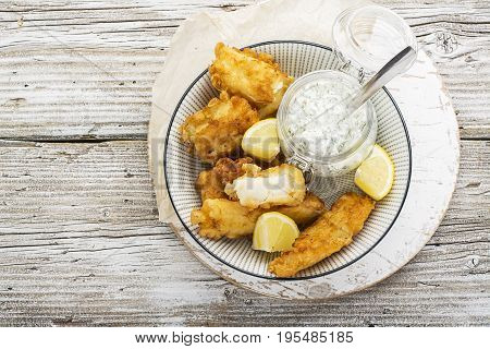 Fish dish - Cod in beer batter with tar tar sauce for a healthy and comfortable diet.