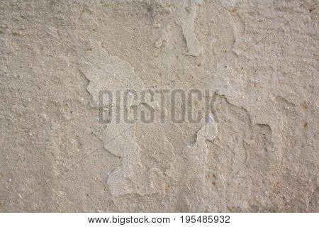 textured background from unevenly smeared cement v