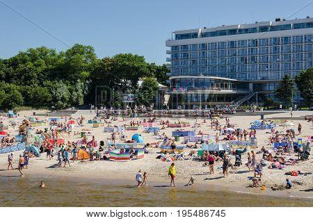 KOLOBRZEG, WEST POMERANIAN / POLAND: Holiday day on the sea beach