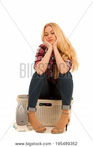 Tired Woman With A Basket Of Loundry Annoyed With Too Much Work Isolated Over White