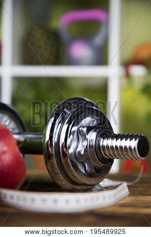 Diet and fitness, dumbbell with vitamin