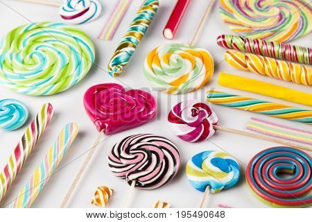 Colorful lollipops and different colored round candy and gum balls