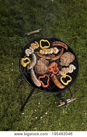 Assorted grilled meat on a summer barbecue, BBQ concept