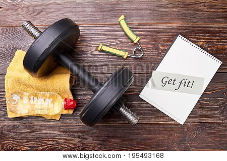 Dumbbell, expander, message, bottle. Get fit in sport gym.