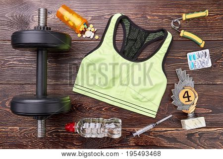 Sport top, prize, dumbbells, pills, syringe. Physical energy and power with medical pills stimulation. Sport and drugs.