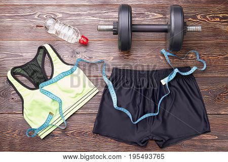 Equipment for heavy women physical training. Sport activity with dumbbell for losing weight.