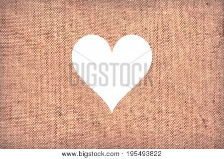 Light pastel pink canvas background with cut out heart shape in the middle wedding romantic concept