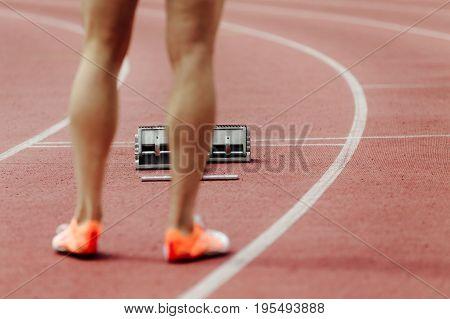 red track and starting blocks athlete runner waiting for start