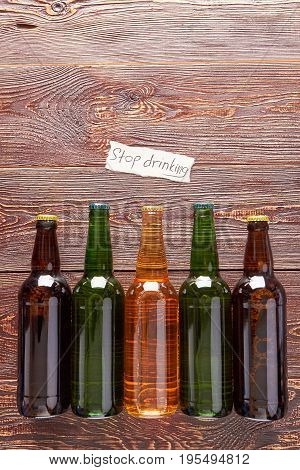 Group of bottles with alcohol beverage. Concept of alcoholism, retro background.