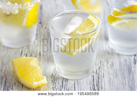 vodka and lemon. Vodka with ice. Selective focus