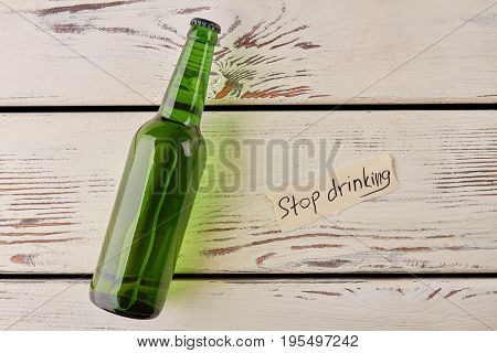 Get rid of alcoholism how to. Stop drinking message, glass bottle of alcohol.
