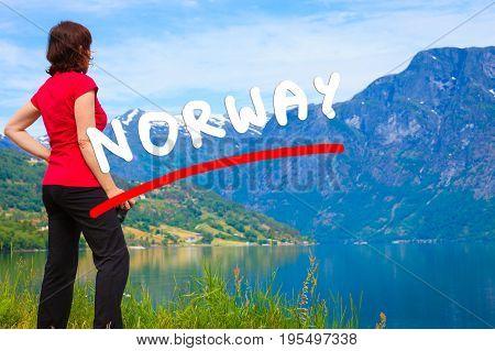 Tourist Woman Enjoying Fjord View In Norway
