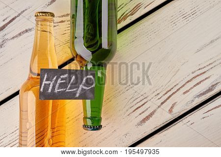 Full bottles, message, copy space. Help with alcohol addiction.