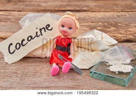 Say no drugs, think about child. Abuse of narcotics harmful for life. Stop play with cocaine.