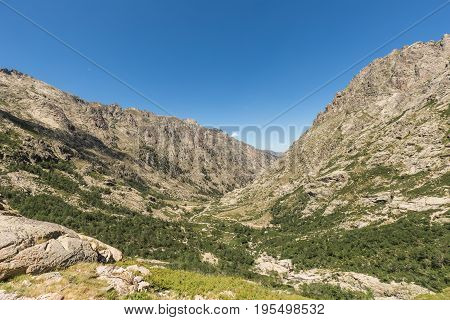Rugged mountains either side of the river in the glacial valley at Restonica near Corte in central Corsica