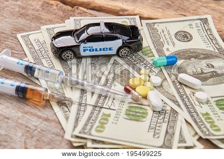 Police car, money, syringes, pills. Do not be loser, say no to narcotics.
