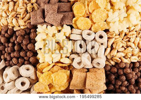 Corn flakes collection closeup in squares cereals background. Top view.