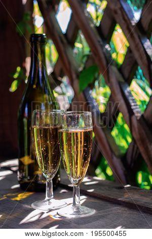 Two Glasses Of White Sparkling Wine In The Gazebo