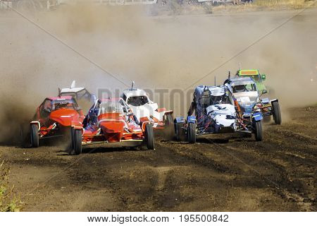 Rally car buggy in a race on the track, wheel slip in a close-up, start a rally race in the dust