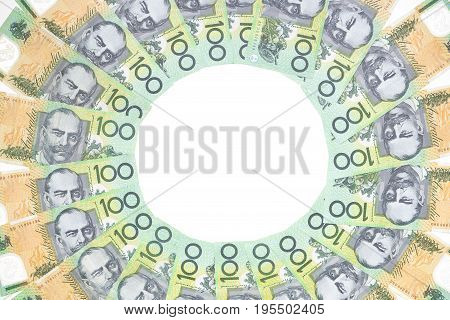 Australian one hundred dollar bills circle pattern on white background.