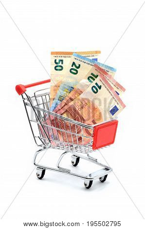 shopping cart with many euros on white background