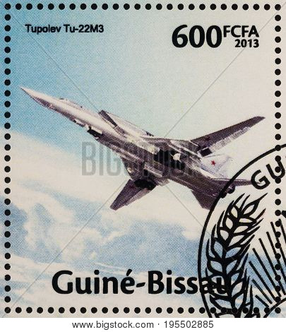 Moscow Russia - July 15 2017: A stamp printed in Guinea-Bissau shows Russian Tu-22M3 Backfire supersonic long-range strategic bomber aircraft series