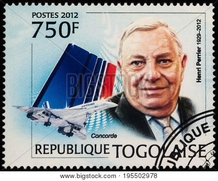 Moscow Russia - July 14 2017: A stamp printed in Togo shows Director of the Concord Project Henri Perrier and airliner Concorde series