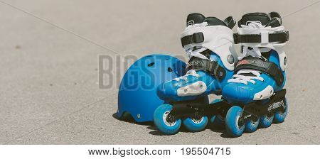 Toned Baner Roller Inline Skates In Skate Park On Gray Urban Background
