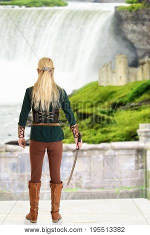 female elf with sword looking at waterfall