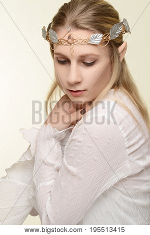 portrait of female elf with gold and silver crown
