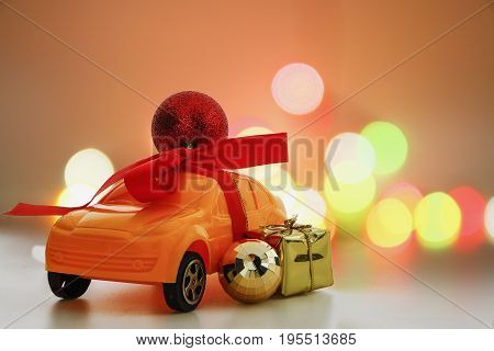 Christmas ornament on toy car Christmas holiday celebration concept with bokeh background