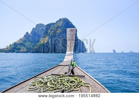 Long tail boat on Andaman sea floating on a water view from a boat Thailand.