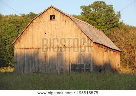 A barn in rural Michigan at sundown