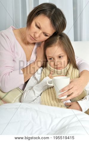 Mother taking care of ill little daughter