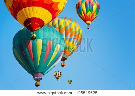 Multi colored hot air balloons against blue sky
