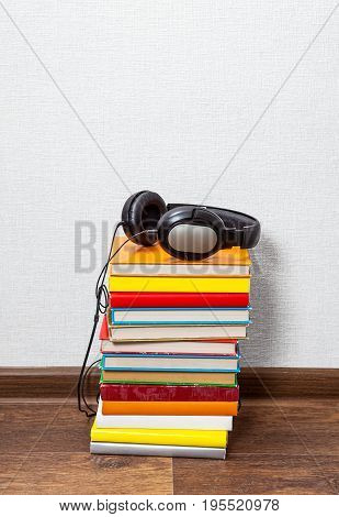Headphones and a Books on the Floor closeup