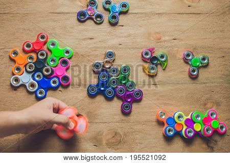 Fidget Spinners On Wooden Background With Copy Space, Popular Relaxing Toy, Generic Design