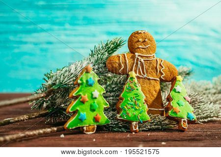 painted gingerbread Christmas tree and the man on a blue background.