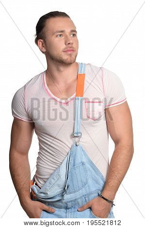 Handsome young man in jean overall isolated on white background