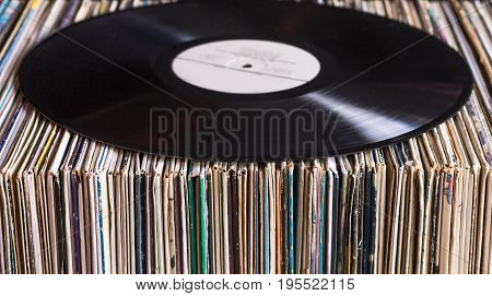 Vinyl record on the collection of albums vintage process