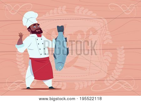 African American Chef Cook Hold Fish Smiling Cartoon Restaurant Chief In White Uniform Over Wooden Textured Background Flat Vector Illustration