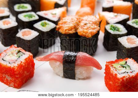 Traditional japanese food delivery. Closeup of sushi set with rolls, gunkan and nigiri at white background