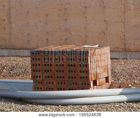 Bricks and conduit piping at construction site
