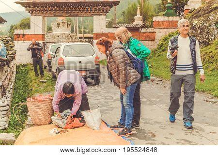 Bumthang Bhutan - September 13 2016: Tourists near the Kurjey Lhakhang (Temple of Imprints) in Bumthang valley Bhutan.